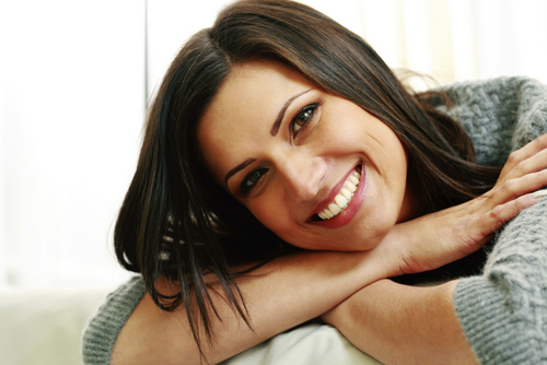 East Dundee, IL woman smiling about the restorative procedure she received from her dentist.